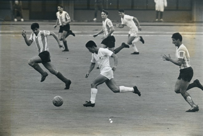 TOKYO, JAPAN - OCTOBER 14:  (CHINA OUT, SOUTH KOREA OUT) Ryuichi Sugiyama of Japan in action during the Tokyo Olympics Football Group D match between Japan and Argentina at Komazawa Stadium on October 14, 1964 in Tokyo, Japan.  (Photo by The Asahi Shimbun via Getty Images)